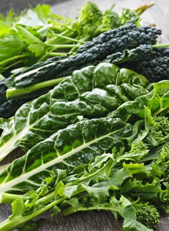 Mandatory Credit: Photo by Monkey Business Images/REX (2164501a) Dark green leafy fresh vegetables on cutting board VARIOUS